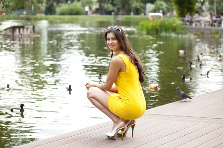 Portrait in full growth, attractive young woman in yellow dress    photo
