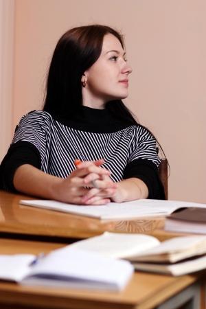 formulae: Female teacher in classroom