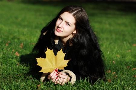 beautiful young woman relaxing in the grass  photo