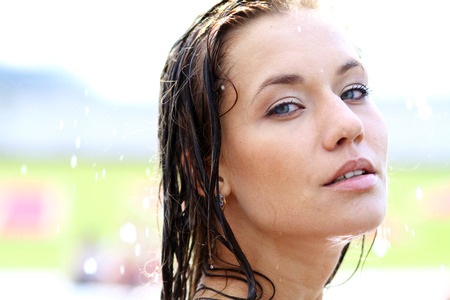 Young happy woman wet in the rain photo