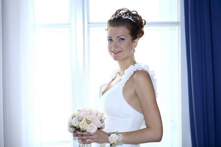 Beautiful brunette bride wearing wedding dress photo