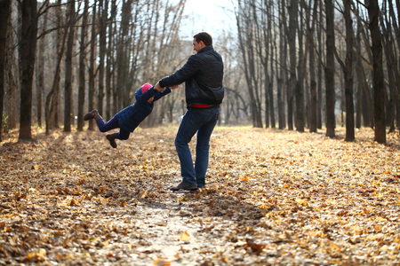 Father and little girl in autumn park photo