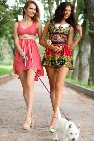 Two cheerful girls in the street photo