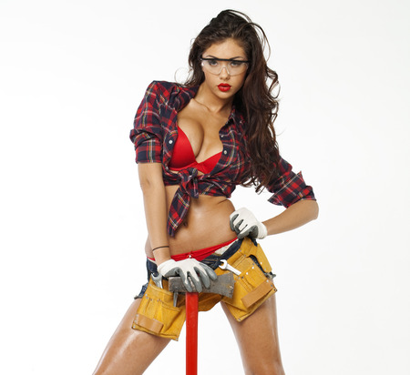 Sexy brunette with an ax in his hand, isolated on white background Stock Photo