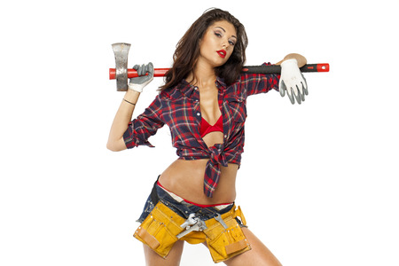 Sexy brunette with an ax in his hand, isolated on white  photo