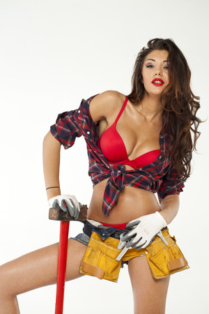 Sexy brunette with an ax in his hand, isolated on white background photo