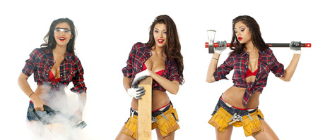 Sexy girl with construction tools isolated on white background photo