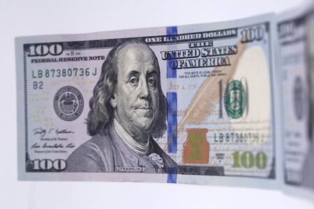 New banknote hundred dollars with protective holographic ribbon