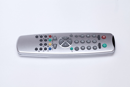 Gray TV remote, isoalted on white photo