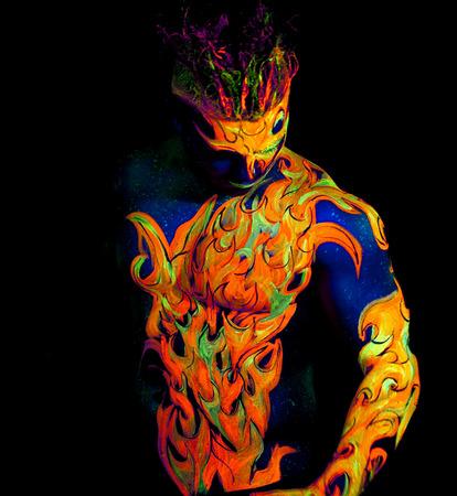 Body art glowing in ultraviolet light photo