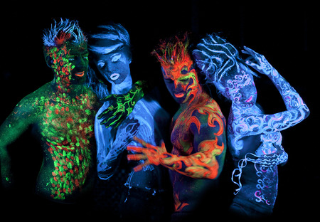 Body art glowing in ultraviolet light photo