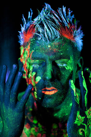 grounding: Body art glowing in ultraviolet light