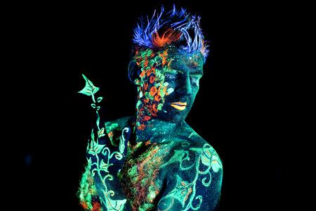 ultraviolet: Body art glowing in ultraviolet light