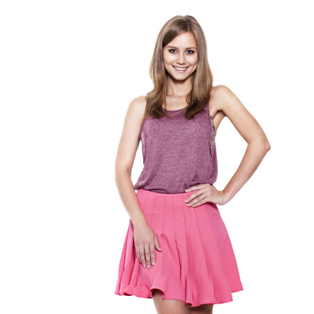 Full length of a beautiful young lady standing against isolated white background  photo
