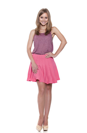 Full length of a beautiful young lady standing against isolated white background