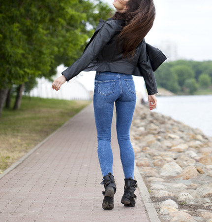 ass jeans: Beautiful female ass in blue jeans back away Stock Photo
