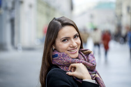 Portrait of young happy woman in red scarf photo