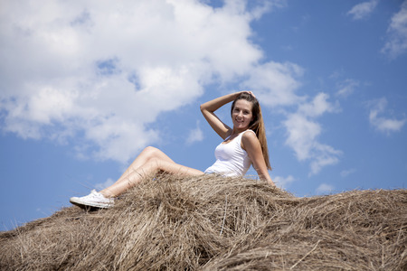 hayloft: Young beautiful girl in the hayloft in the village