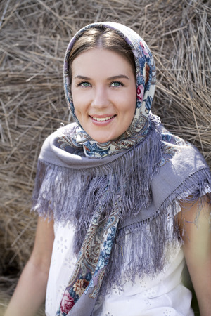 hayloft: Portrait of young happy woman in blue scarf