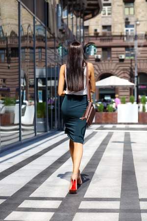 Young beautiful brunette woman with a bag in his hand photo