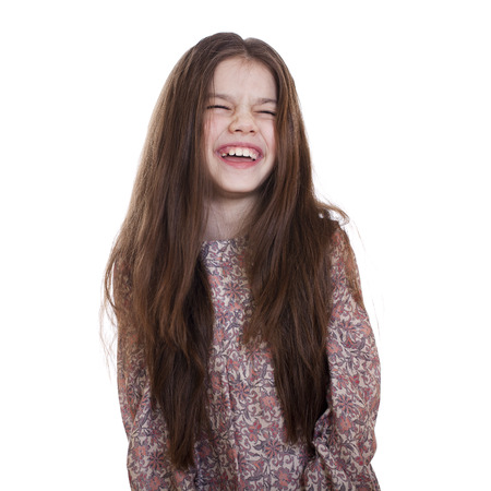 Young beautiful girl laughs a lot of fun, on white isolated background 版權商用圖片