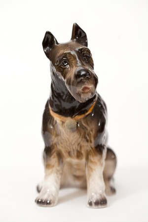 adeptness: Riesenschnauzer. Ceramic figurine, dog breed isolated on white Stock Photo
