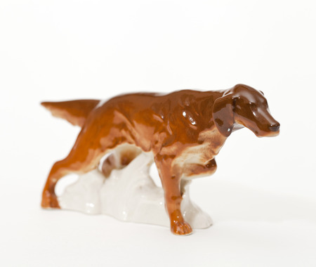 adeptness: Irish red Setter. Ceramic figurine, dog breed isolated on white