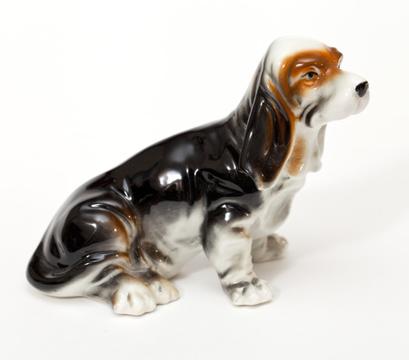 adeptness: Basset Hound. Ceramic figurine, dog breed isolated on white