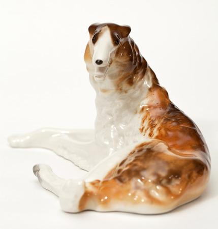 hound: Hound hound. Ceramic figurine, dog breed isolated on white