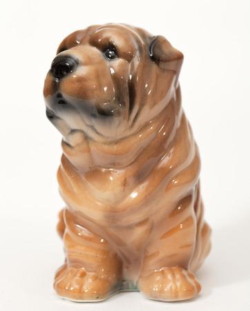 adeptness: Shar pei puppy. Ceramic figurine, dog breed isolated on white Stock Photo