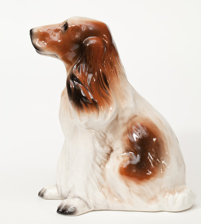 adeptness: Cocker Spaniel. Ceramic figurine, dog breed isolated on white Stock Photo