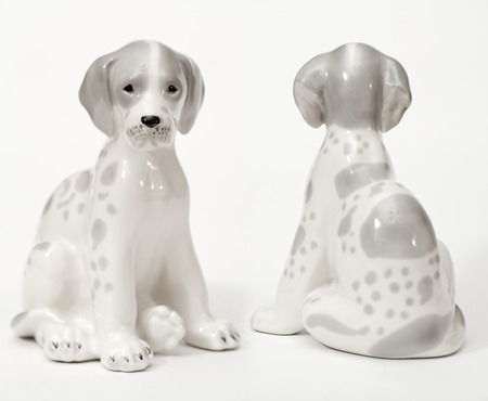 adeptness: Spotted Dalmatians. Ceramic figurine, dog breed isolated on white