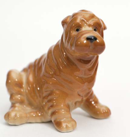 adeptness: Shar pei puppy. Ceramic figurine, dog breed isolated on white Stock Photo