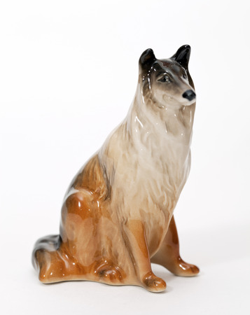 adeptness: Collie. Ceramic figurine, dog breed isolated on white