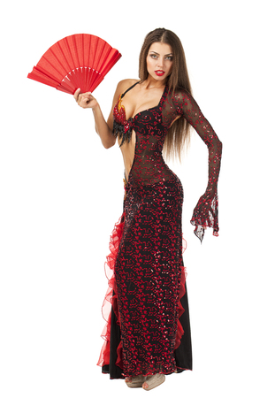 Sexy Woman traditional Spanish Flamenco dancer dancing in a red dress with a white fan photo