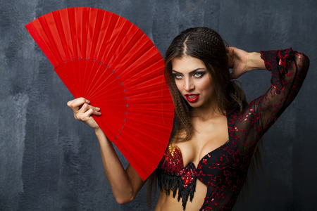 Sexy Woman traditional Spanish Flamenco dancer dancing in a red dress with fan 写真素材