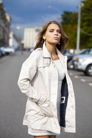 topcoat: Portrait close up of young beautiful woman in white coat Stock Photo