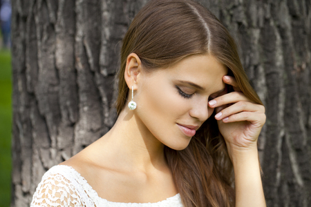face in tree bark: Portrait close up of young beautiful woman, on green background summer nature