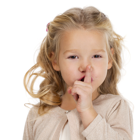 four person only: Young beautiful Little girl  has put forefinger to lips as sign of silence Stock Photo