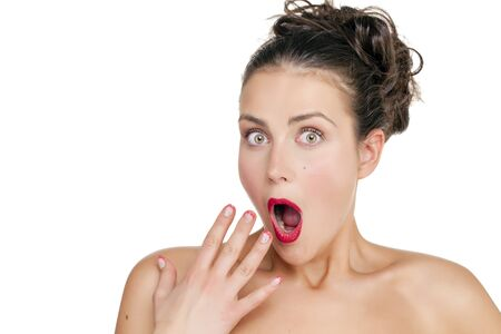 mouth opened: Surprised woman with opened mouth and big eyes holding hands the face and looking happy isolated on white background