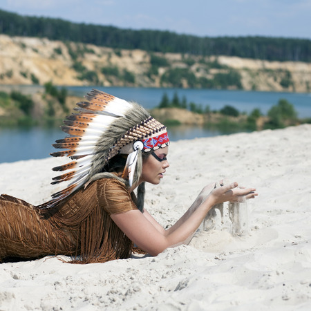 tribal woman: Young woman in costume of American Indian Stock Photo