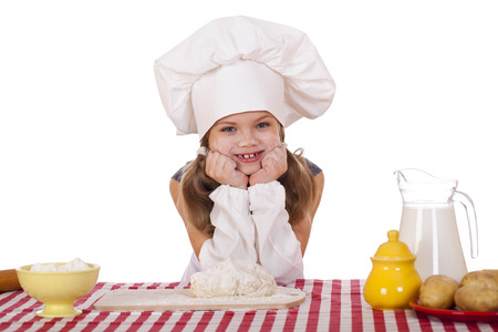 Beautiful little baby dressed as a cook, isolated on a white background photo