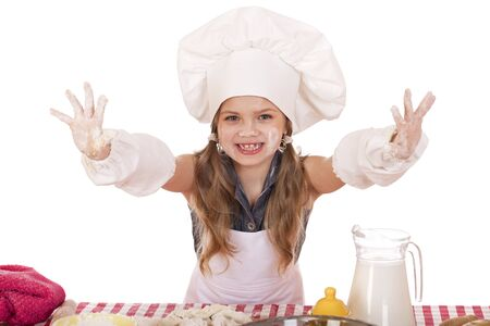cute little girl baking on kitchen and shows hands isolated on a white background photo
