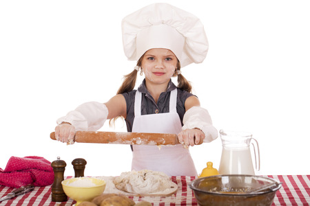 rollingpin: Сute little girl baking on kitchen and shows rolling-pin, isolated on a white background