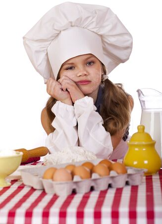 Cute little baby dressed as a cook, isolated on white background photo