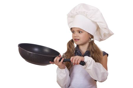 cooking and people concept - smiling little girl in cook hat with frying pan photo