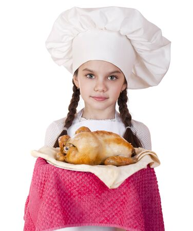 Little girl in a white apron holds on a plate of fried chicken, isolated on white background photo