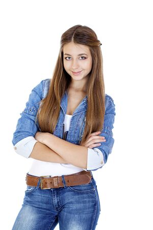 16 years: Portrait of a young girl teenager in jeans jacket and blue jeans, isolated on white background