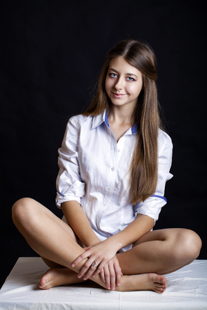 Young attractive girl in white shirt, studio isolated shot Stock Photo