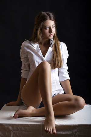 blouse sexy: Young attractive girl in white shirt, studio isolated shot Stock Photo